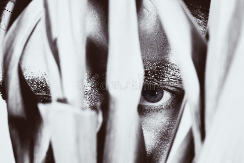 Eye peeping young man stock images