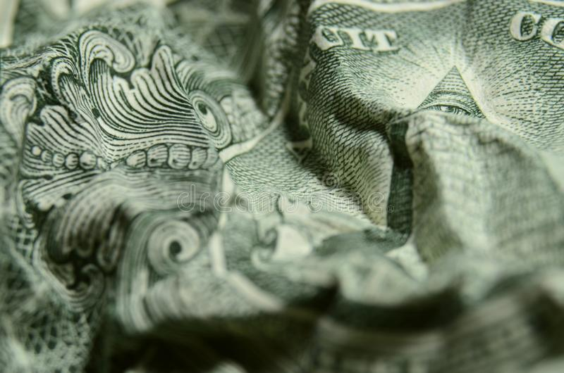 Eye of providence, from the great seal, on the American dollar bill, spying. Shallow focus on the eye of providence, above the pyramid, from the USA coat of stock images