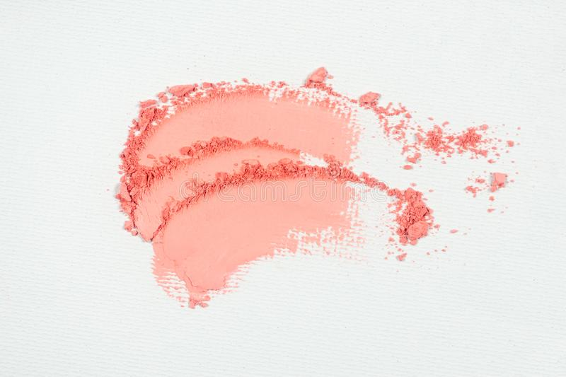 Pink eye shadow or pink bronzer smudge on white background.  stock image
