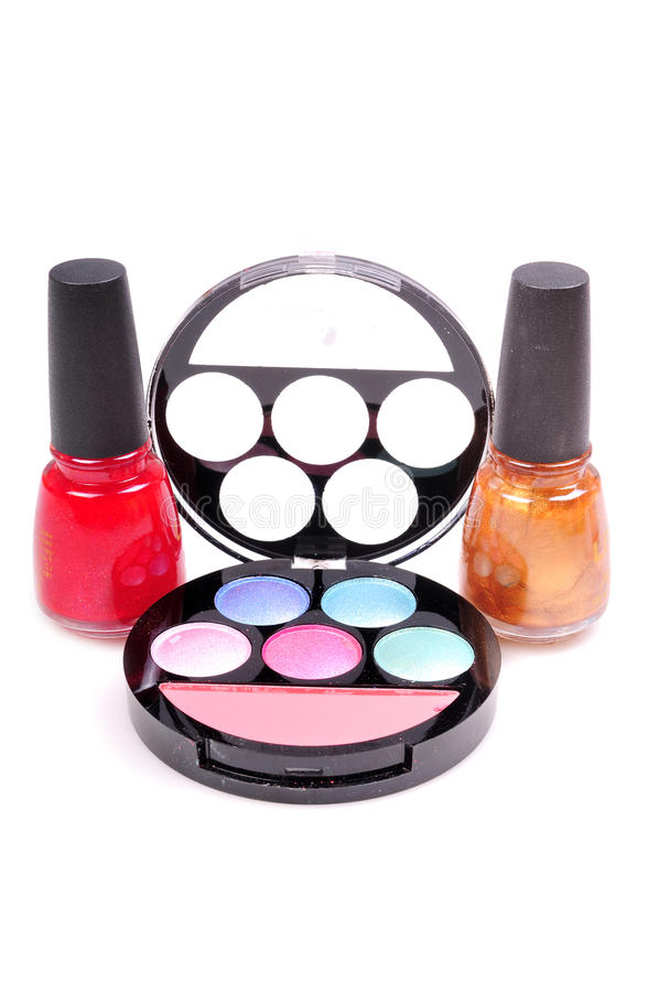 Eye shadow kit and nail paints stock photography