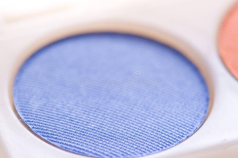 Eye shadow macro. Blue textured eye shadow macro royalty free stock photo