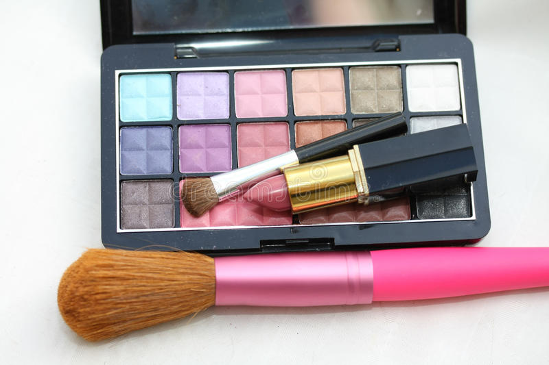 Eye shadow palet with lipstick and brush stock photo