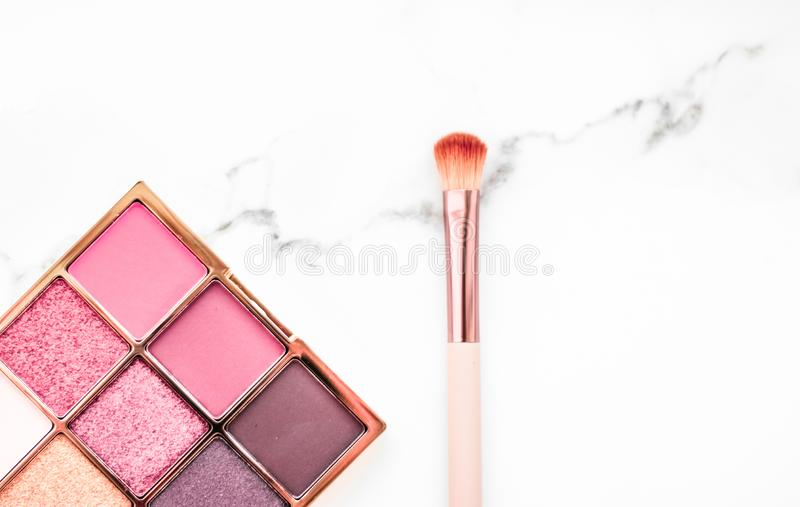 Eye shadow palette on marble background, make-up and cosmetics product for luxury beauty brand sale promotion and holiday flatlay royalty free stock photography