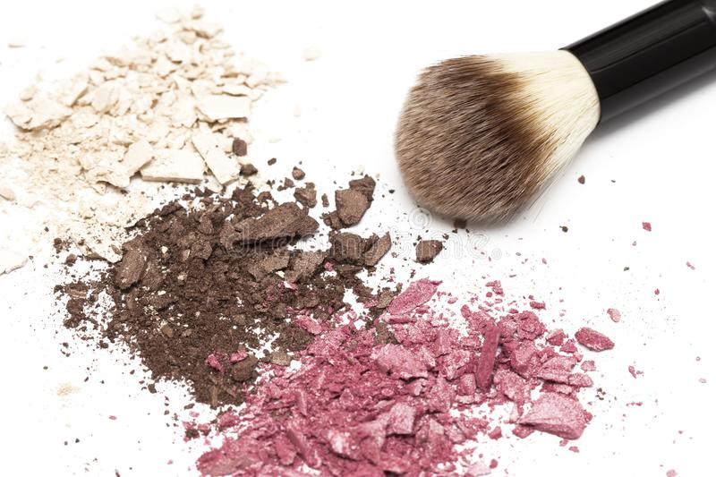 Eye shadow texture and powder brush on white background royalty free stock images
