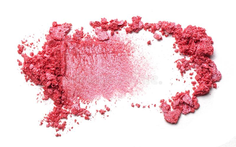 Eye shadow on a white background. Scattered blush sample for makeup. Red color. stock photos