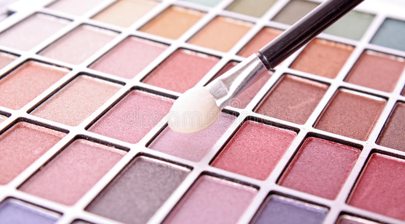 Eye shadows. Big eye shadow kit and applicators stock image