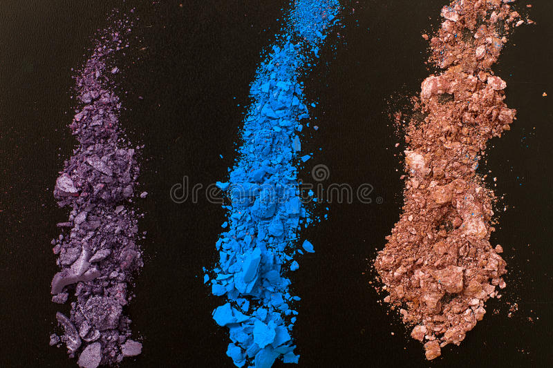 Eye shadows on black background. Crushed cosmetic. Make up cosmetics. Top view and mock up. Eye shadows on black background. Crushed cosmetic. Make up cosmetics royalty free stock photo