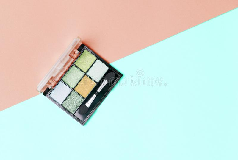 Eye shadows palette on pink and blue background stock images