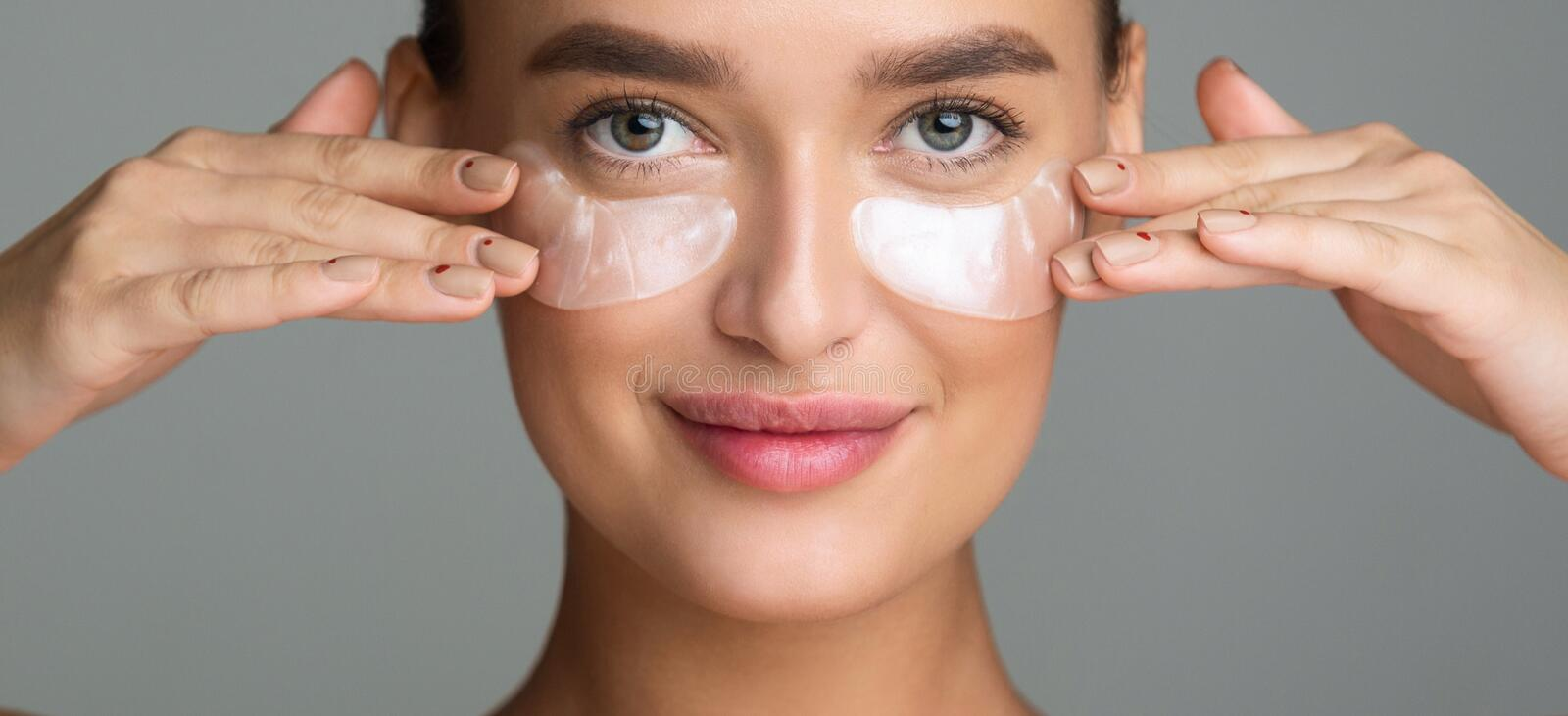 Eye Skin Treatment. Woman Applying Under Eye Patches royalty free stock photo