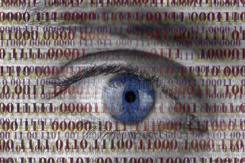 Eye spy. Closeup of human eye with digital binary code. Concept of internet spying