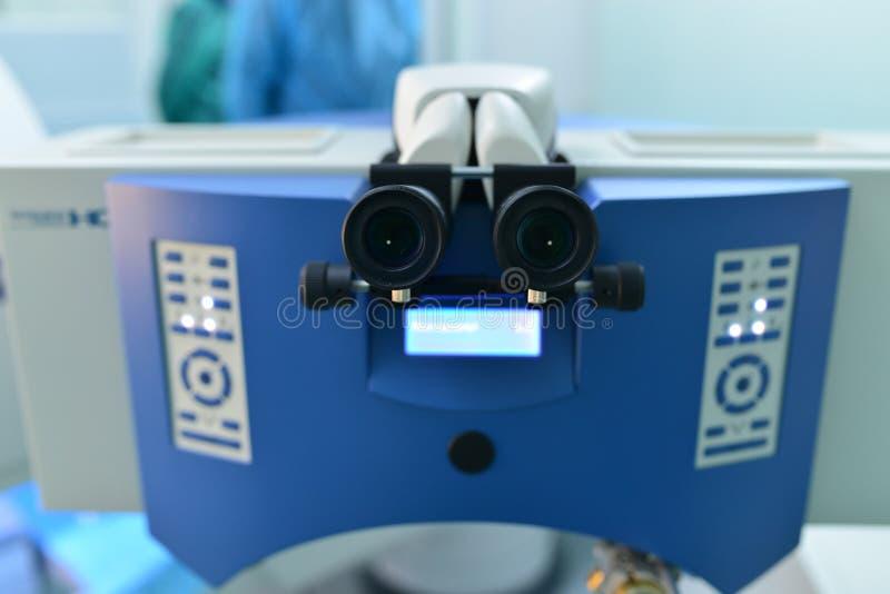 Eye surgery laser. Eye cornea surgery laser medical device detail stock photography