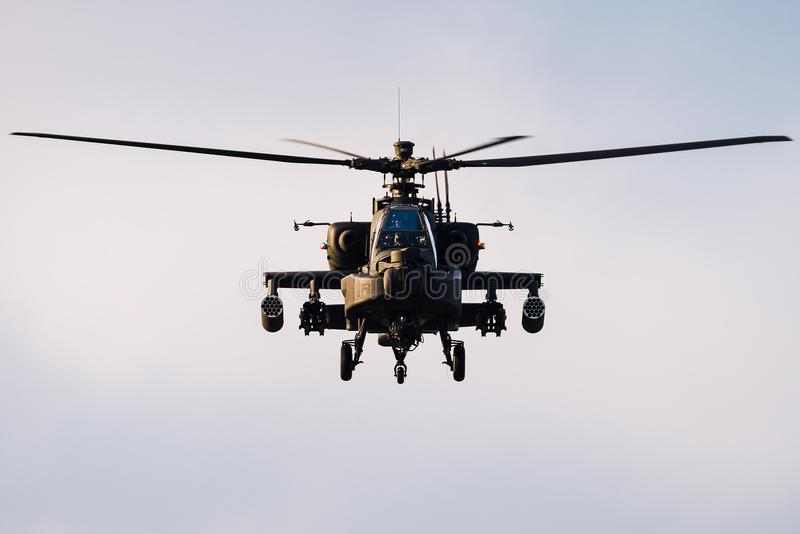 Looking at the front of a hovering Apache Longbow helicopter royalty free stock image