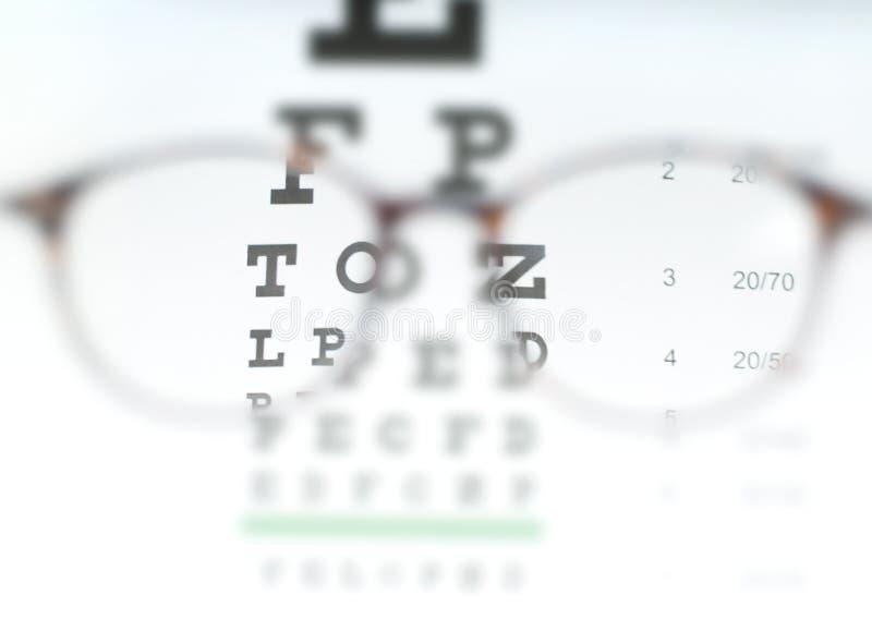 Eye vision test chart seen through eye glasses. stock photo