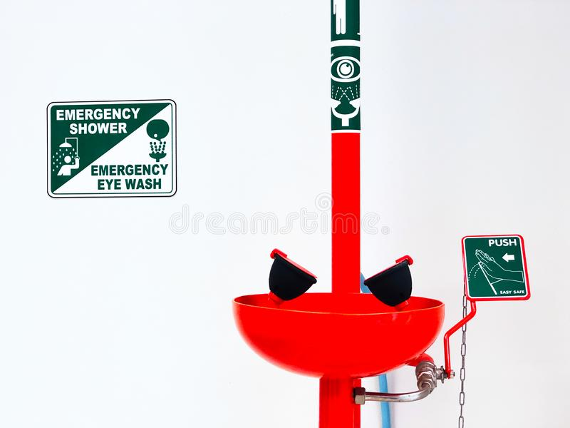 Eye wash station and push on button sign for flowing the water washing eyes injury or touch with Acid or toxic chemical, safety. stock photo