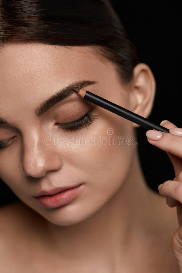 Eyebrows Contouring. Beautiful Woman With Brown Eyebrow Pencil stock images