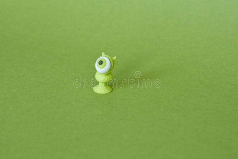 Eyed little green worm. Little green-eyed snake or a worm on a green background stock photography