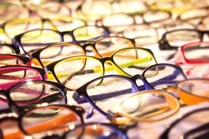Eyeglass assortment for prescription sold at a pharmacy or optician near you. Variety of colors and styles to suit your needs and stock photos
