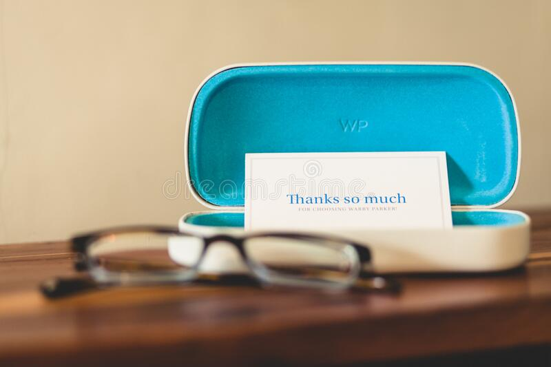 Eyeglass case with Thank You note stock photo