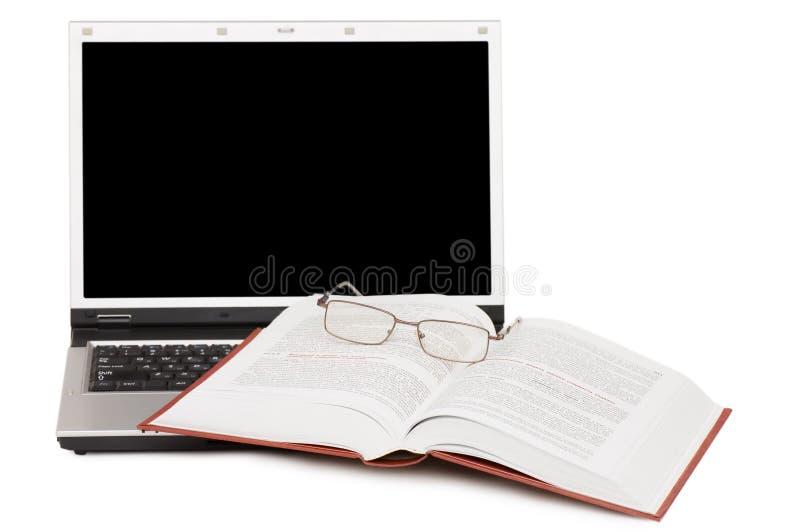 eyeglasses βιβλίων lap-top στοκ φωτογραφία με δικαίωμα ελεύθερης χρήσης