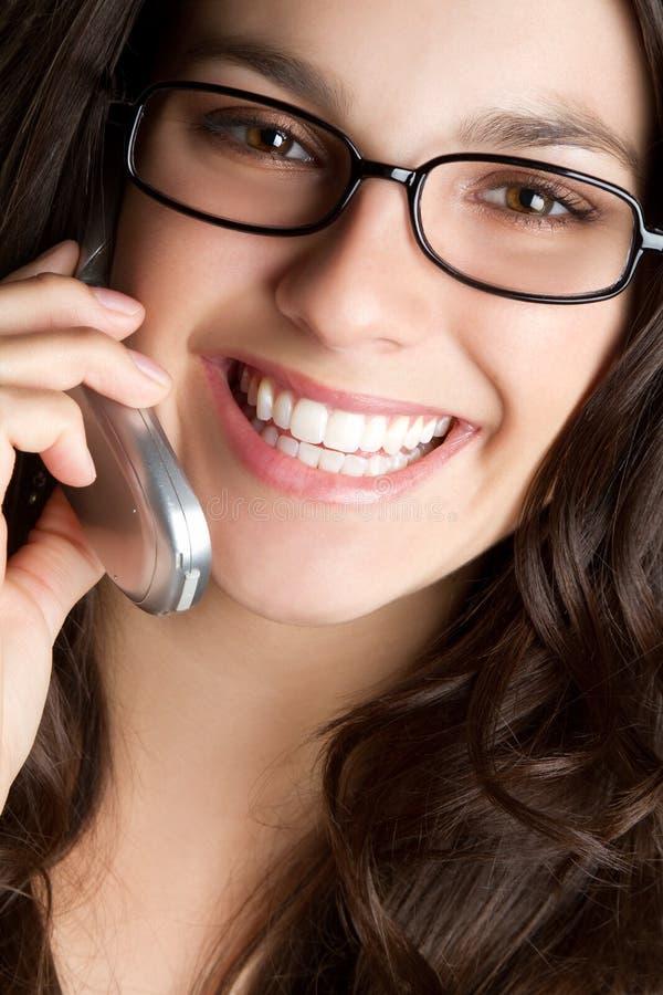 eyeglasses τηλεφωνική γυναίκα στοκ φωτογραφία με δικαίωμα ελεύθερης χρήσης