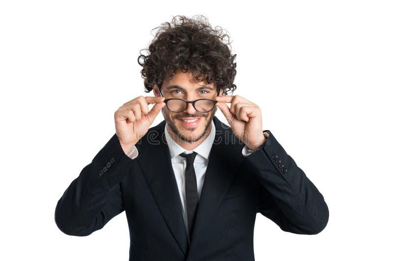 Eyeglasses бизнесмена нося стоковое фото