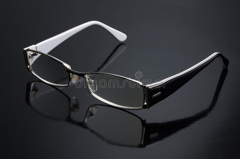 Eyeglasses. On a black background royalty free stock photos