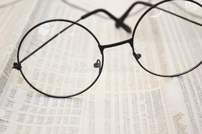 Eyeglasses on accounting papers. royalty free stock photography