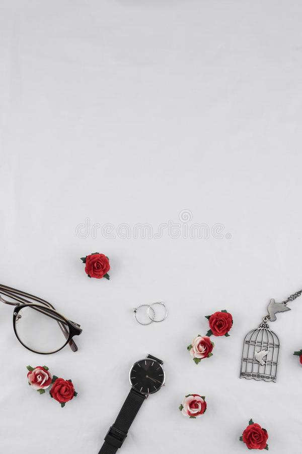 Eyeglasses, black watches, necklace and rings royalty free stock photo