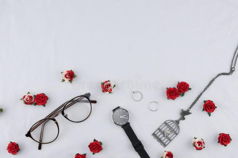 Eyeglasses, black watches, necklace and rings royalty free stock photos