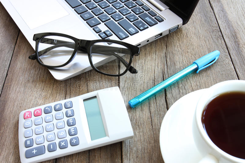 Eyeglasses and blue pen on the wooden work table. Eyeglasses and blue pen on the wooden work table,concept of business views stock images