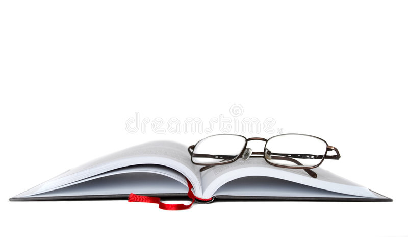 Eyeglasses with book stock image