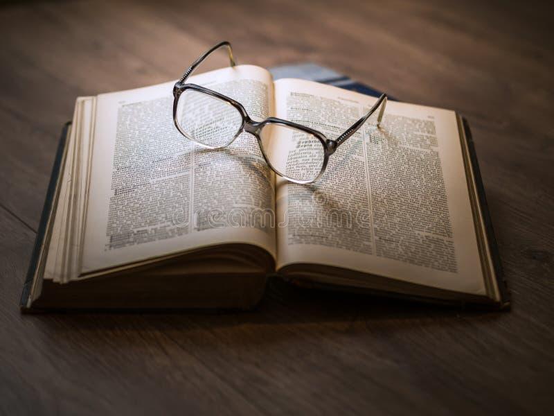 Eyeglasses on book stock photo