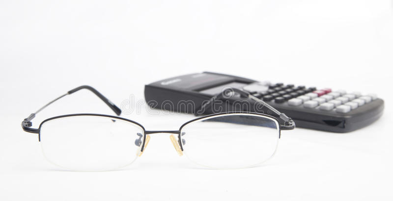 Eyeglasses with calculator royalty free stock image