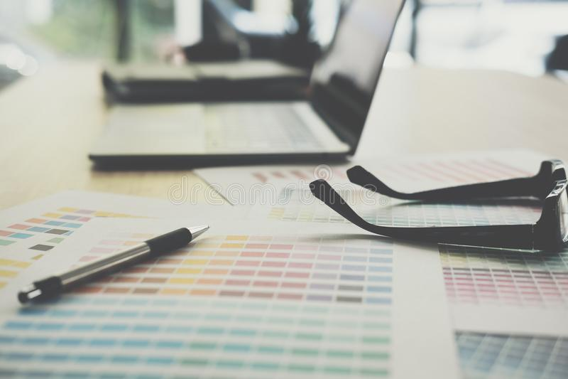 Eyeglasses, color swatch on office desk. graphic designer workspace. creative design work. business workplace concept. Eyeglasses, color swatch sample on office stock images
