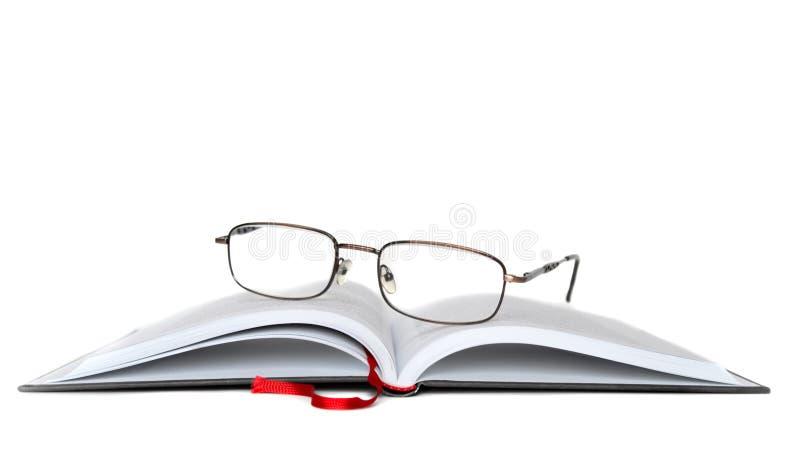 Eyeglasses com livro fotos de stock