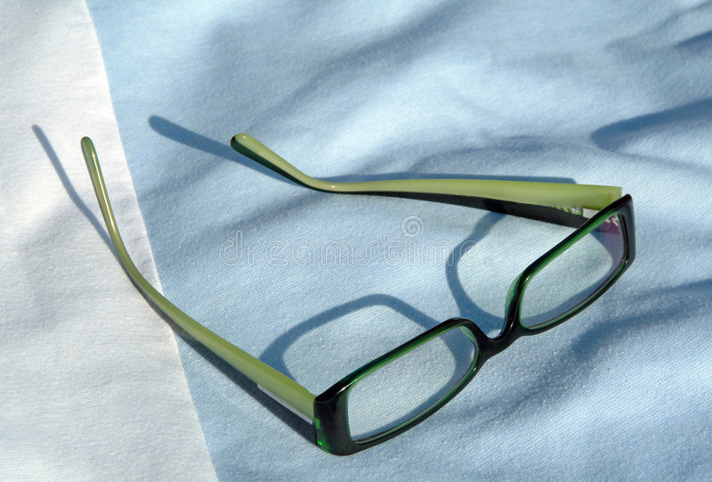 Eyeglasses on fabric background stock photography