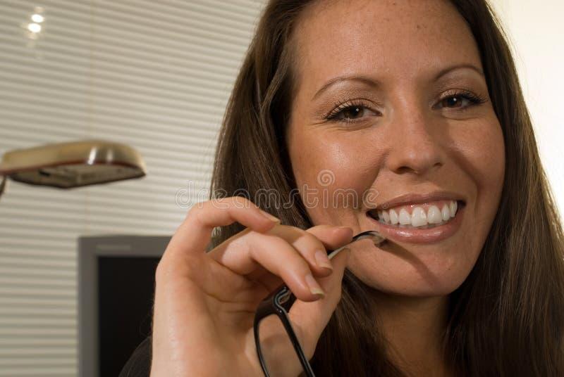 eyeglasses holding woman arkivfoto