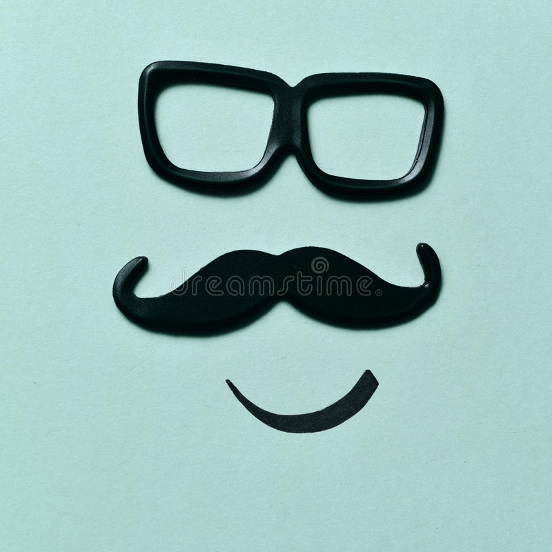 Eyeglasses i wąsy tworzy twarz fotografia stock