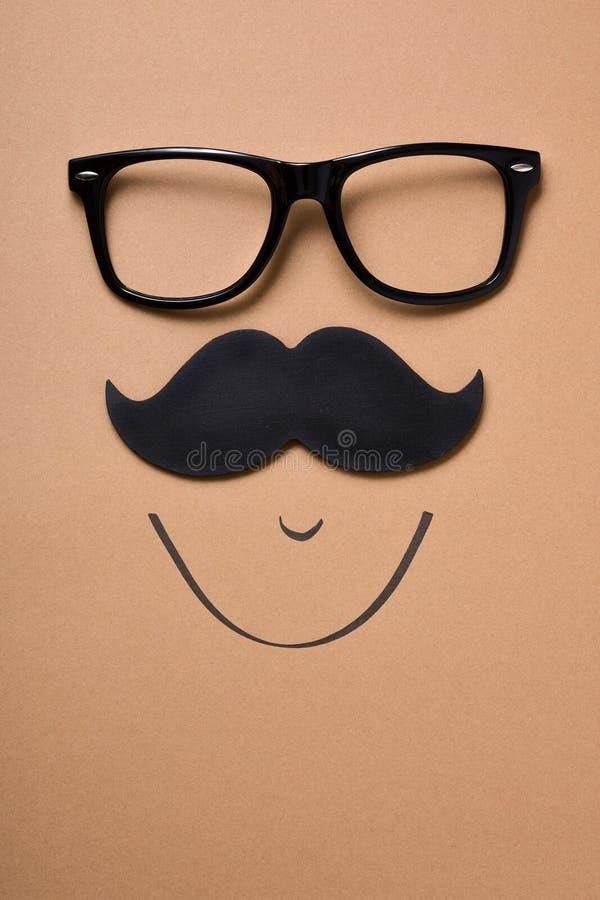 Eyeglasses i wąsy tworzy twarz zdjęcia stock