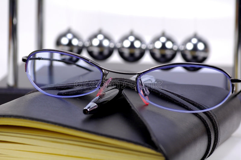 Eyeglasses And Journal Royalty Free Stock Images