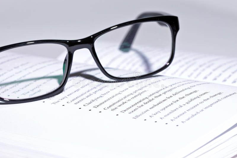 Download Eyeglasses lie on the book stock image. Image of closeup - 22311983
