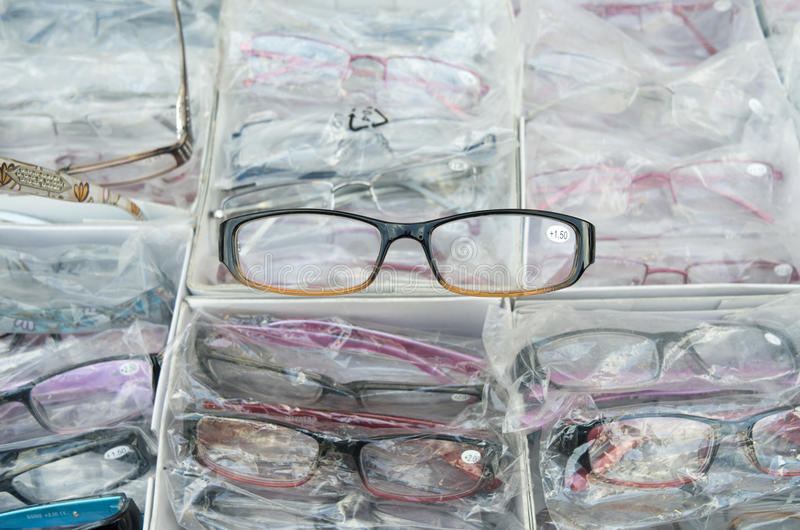 Eyeglasses in a market stall. Eyeglasses in a market stall at the Albert Cuyp market in Amsterdam royalty free stock images