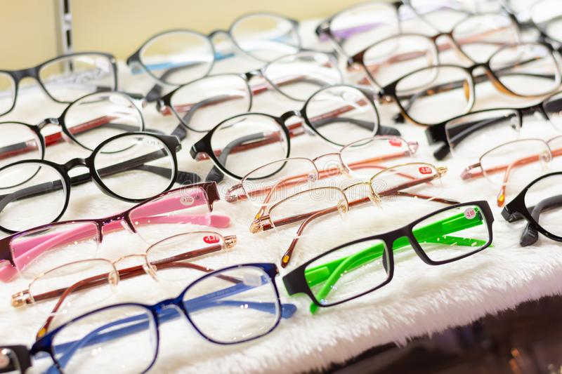 Eyeglasses with myopia diopter scale displayed on shelf. Eyeglasses with myopia diopter scale displayed on shelf in the department store stock image