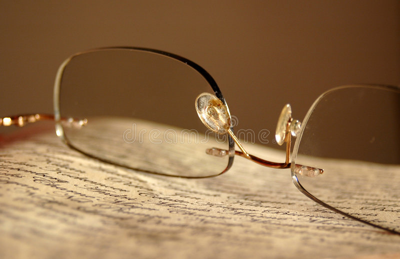 Eyeglasses on newspaper stock photography