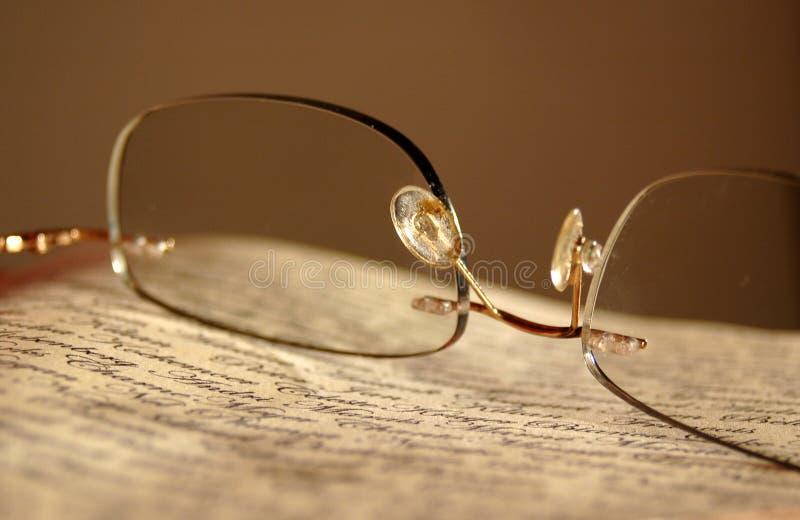 Eyeglasses on newspaper. Eyeglasses on an old vintage newspaper stock photography