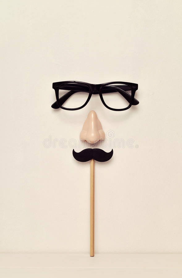 Eyeglasses, nose and mustache depicting a man face royalty free stock photos