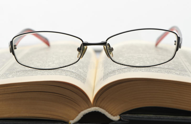 Download Eyeglasses On The Old Thick Book Stock Image - Image: 21598875