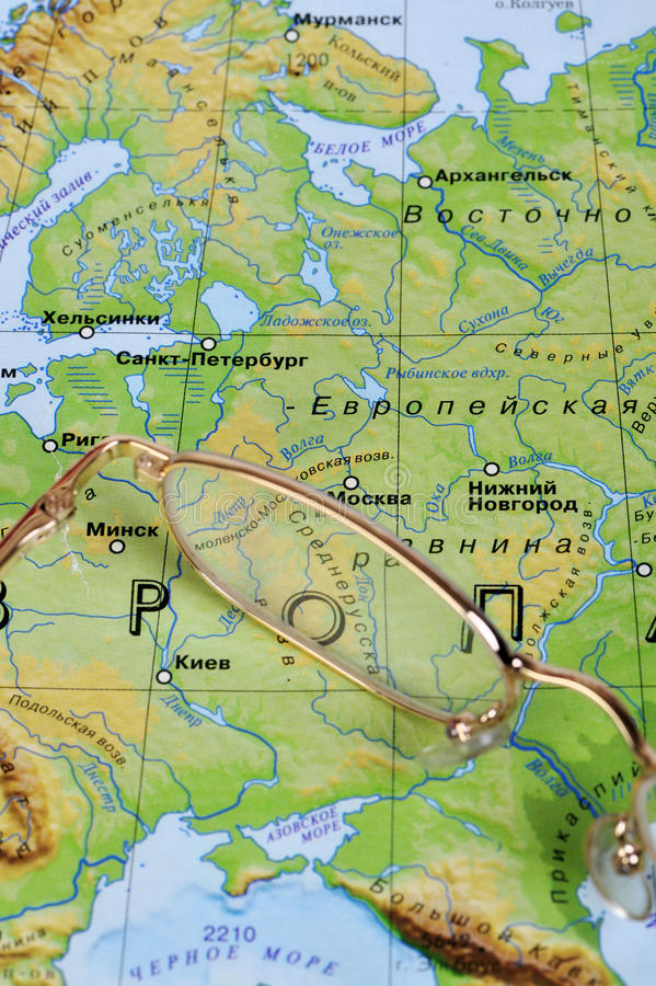 Free Eyeglasses On A Geographic Map Stock Images - 9788424