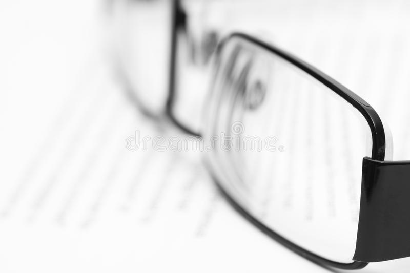 Eyeglasses on open book. In black and white stock photos