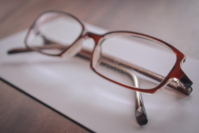 Eyeglasses on paper royalty free stock photos